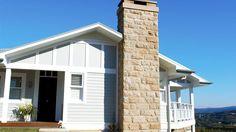 Newport House » Hamptons style traditional coastal home, sandstone chimney, front porch. Stritt Design & Construction