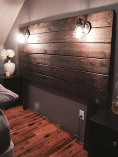 Custom plank headboard with lampsYou can find Lamps and more on our website.Custom plank headboard with lamps