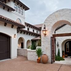 Spanish-Style Home with Arched Stone Entry Gate