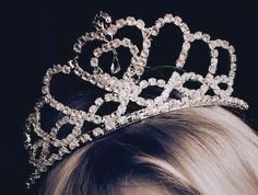 buy her a crown as a gift and tell her that she can finally show the world shes a real princess