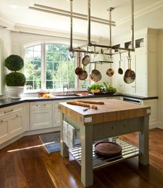 Square kitchen island with butcher like countertop
