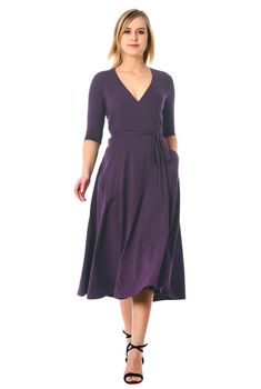 Floaty wrap styling highlights our cotton knit dress cinched in at the seamed waist with attached half-ties.