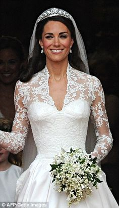 Mirror image: The 31-year-old hotel heiress may have been inspired by Kate Middleton's iconic wedding gown (pictured), which was designed by Alexander McQueen head designer Sarah Burton