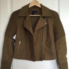 Aritzia Wilfred Free Moto Jacket New with tags attached. Featuring intricate trapunto stitching, this fully lined moto jacket is made from a textured linen and cotton fabric (71% Linen, 29% Cotton). Bold metal zippers add instant attitude to the design. Aritzia Jackets & Coats