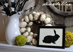 Easter Mantle ideas. Bunny silhouette and the cool egg wreath w wire is awesome!