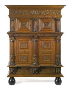 A French Renaissance carved walnut buffet à deux corps part 16th century height 83 in.; width 69 1/2 in.; depth 24 in.