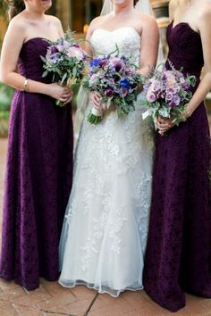 Bride wearing white J-Johnson sweetheart neckline while her bridesmaids' are wearing plum A-line dresses by Madeline Gardner. Both are holding bouquets with purple dahlia, callia lilys, delphiniums, and peonies with green accents.  Thomas Shull Photography  villa siena.cc