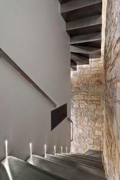 Lit steel staircase in a tower in Rovinj, Croatia by Giorgio Zaetta
