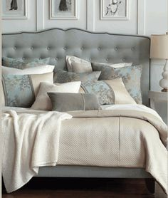 Beautiful Tufted Headboard with grays whites and creams creating a neutral colored room