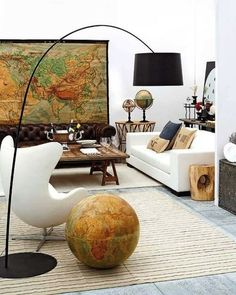 """A living room with eclectic style. Love the brown leather chesterfield sofa mixed with the white furniture and walls, making the map and globe really stand out. A previous pinner called it """"Global Living."""" I must agree...V"""