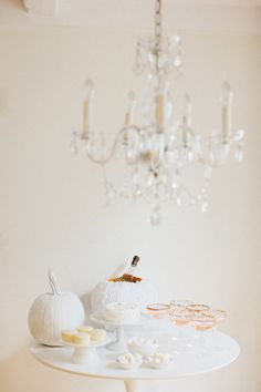 White pumpkins for wedding used as table decor and wine cooler