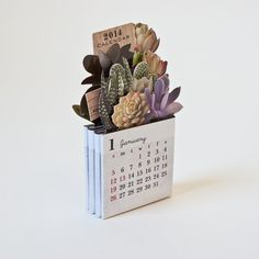 This fresh little 2014 desk calendar clicks and clacks apart every month to reveal a fine range of succulents and cacti.