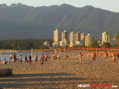 Playing beach vball...who wouldn't love the view of the #Vancouver mountains and water