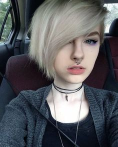 Girls white hair septum piercing