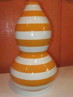Orange striped ceramic vase.