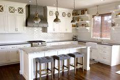 White inset cabinets. Fantasy White Granite Island. Faux finished range hood. Open kitchen shelves. White subway tile. White Kitchen.
