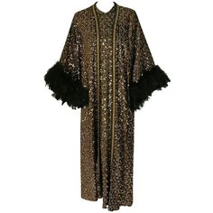 Preowned 1975 Lucille Ball Celebrity Owned Gold Sequin Hourglass Gown... (€5.680) ❤ liked on Polyvore featuring outerwear, coats, black, evening gowns, feather coat, trapeze coat, long swing coat, gold sequin coat and sequin coat