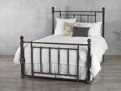 The Hancock iron bed stands with substantial presence, contributing unprecedented warmth and character to any bedroom. An updated take on a classic design, Hancock's straight, no-nonsense lines speak of practicality and pragmatism, while decorative finials and carefully-wrought joints ensure that the overall impression is one of carefully-designed, quality craftsmanship. Every angle is a right angle, and the footboard echoes the headboard almost minutely, but the consistency is far from…