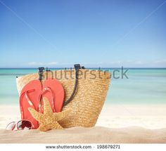 Summer concept with accessories on sandy beach by Jag_cz, via Shutterstock