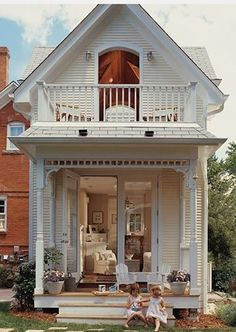 Country Look: Small country house with a upstairs loft balcony.Home has French doors on the 1st floor.