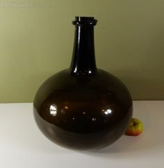 A Large Early 19th Century Onion Shaped Wine, or Spirits Bottle.