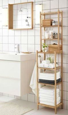 Get organized and relaxed in your bathroom with the IKEA RÅGRUND shelving unit in bamboo!