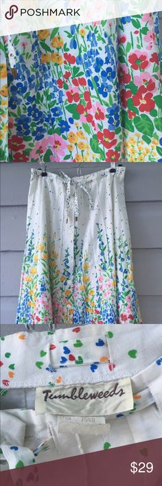 Vintage floral circle skirt This beautiful vintage skirt is like wearing a watercolor painting. The details are stunning. Size large, cotton, no stretch. Excellent used vintage condition. Button detail down front, ties at waist, and vibrant color palette. Tumbleweeds Skirts A-Line or Full