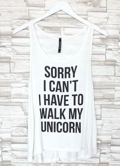 """Super rad white tank features """"Sorry I can't, I have to walk my unicorn"""" graphic on the front. Tank has a soft, flowy, perfect fit! Style this top with some highwaisted shorts and sneakers. MADE IN USA"""