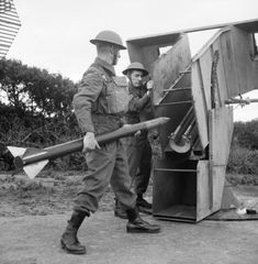 Home Guard soldiers load an anti-aircraft rocket at a 'Z' Battery on Merseyside, 6 July 1942.