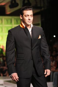 ndian Bollywood actor Salman Khan wears a creation by Ashish Soni at the third and concluding day of Van Heusen India Men's Fashion Week in New Delhi