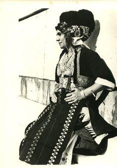 A woman wearing the bridal costume of Gidas, Imathia, Macedonia, in the Panathenaic Stadium, Athens. Photo: Nelly's. Late 1930s ©Peloponnesian Folklore Foundation, Nafplion, Greece
