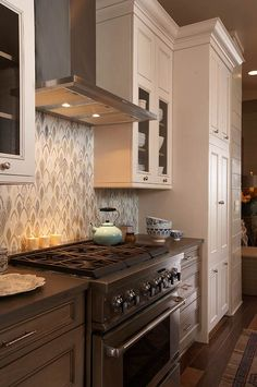 Not the wallpaper, but the use of two toned cabinets, especially around the stainless appliances.   Design Ideas for White Kitchens