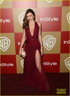 Miranda Kerr - Warner Bros and InStyle Golden Globe Awards After Party - Zuhair Murad burgundy chiffon gown featuring a plunging neckline and high slit, Salvatore Ferragamo bag and shoes, and H. Stern jewelry.