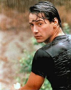 Keanu Reeves....I had a black and white poster of this picture in my room, and it was heaven! Keanu wet....works for me!