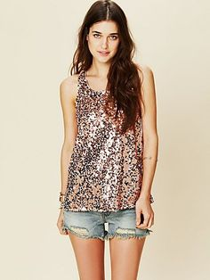 http://www.freepeople.com/clothes-the-tee-shop/sequin-cami-24963951/_/productOptionIDS/B65CC2C7-A1F9-4E0F-A678-89DAB39064A7  Free People sequin shirt in rose gold