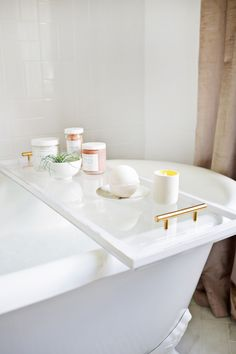 Lucite Bathtub Caddy | A Beautiful Mess I sadly don't have a bathtub at home. Sigh. One day. But I've been looking for a tray to go on my sideboard at home that will fit all my perfumes, candles and various other bits and pieces that I have on...
