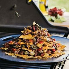 A delicious twist on the classic nachos, our version incorporates the traditional ingredients for fajitas: grilled skirt steak, bell peppers and onions. This hearty appetizer is cooked entirely on a backyard grill.