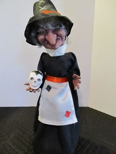 """Here we have a common Witch made by Telco. Its 17"""" tall runs on 2-C batteries. It was originally purchased at Walgreens for $19.99. Although it has that typical Witch face, most Telco witches tended to have a larger nose then the generic witches made by other companies who all used the same witch face 99% of the time. Also, the commonly used Skull in her hand has a bat painted on the top, so that was different to."""