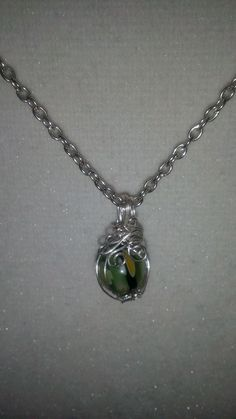 Green glass blown sphere necklace
