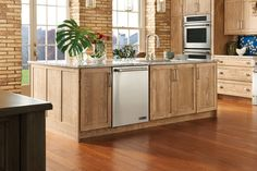 Potter's Mill Reverse Raised Panel oak Cappuccino; hutch and island are Madison Raised Panel cherry Appaloosa; table is cherry Chestnut.  Purchase Medallion Cabinetry direct from factory; 650-704-2221