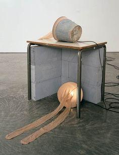 She likes it cozy, 2005Wood table, breeze blocks, steel buckets, nylon tights, light bulbs (via Gladstone Gallery)