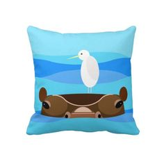 Cute Bird on Hippo Pillows. This cute pillow makes for a fun design accent in a nursery, kids room, or the home of any wildlife lover. #hippos #wildlife #wildlfieillustration #kidsroom #babysroom #cutebirthdaygifts #cutegifts #animals #cuteanimals