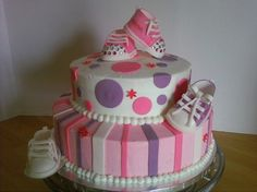 Lots of cute baby shower cakes