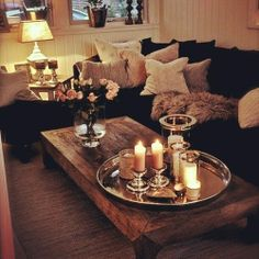 Cozy living room. Like the dark couch with light pillows