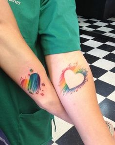 Rainbow matching tattoos.. I like the out line one.