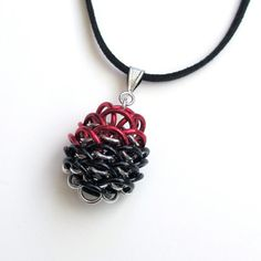 Black & red chainmaille Dragonscale pendant by TattooedAndChained, $25.00