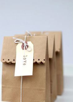 This sweet and simple gift and favor packaging idea comes from The Party Studio. A brown paper bag can be dressed up in so many ways, and I never get tired of seeing fun new projects that incorporate this humble supply. Grab some decorative edging scissors or an edging paper punch (to fancy up the top of the bag), a little twine or string, and tags of your choice to create everything from party favors to Valentine's Day goody bags for the classroom to gifts for family and friends.