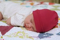 Free Pattern and Tutorial For A Simple Newborn Baby Hat. You could even use a new or re-cycled t-shirt. #sew Donate to a worthy cause like Project Humanity's Purple Slip Campaign.
