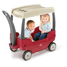 """Step2 Canopy Wagon design features two contoured seats with seatbelts and deep leg well with molded-in drain holes. Long handle for easy pulling that folds under wagon for easy transport and storage. Molded-in cup holders can hold two drinks. 17"""" x 31"""" easily detachable plastic canopy protects children from the sun and rain. Canopy features two cup holders and a compartment for small items. Adult assembly required."""