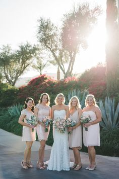 Bridesmaids look cheerful in their different style dresses that speak to their unique personalities. Wedding Photographer: Randy + Ashley.